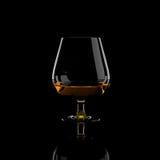 一口威士忌酒杯科涅克白兰地 免版税库存图片