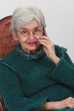 老电话妇女 免版税库存照片