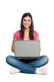 女孩膝上型计算机微笑的工作 库存图片