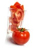 在玻璃的蕃茄和片式 免版税库存图片