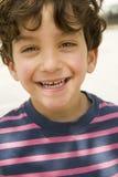 孩子纵向微笑 免版税库存照片