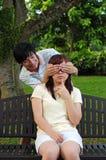 演奏年轻人的亚洲夫妇比赛 图库摄影