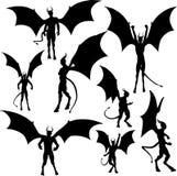 силуэты дьявола Стоковые Изображения