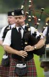 在高地比赛的风笛在苏格兰 免版税库存照片