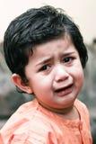男孩哀伤的一点 免版税库存照片