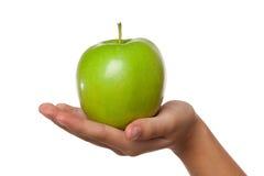 яблоко - зеленая рука Стоковая Фотография