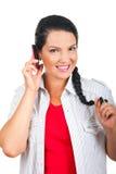 有电池的交谈电话妇女 免版税库存照片