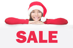 董事会销售额显示符号妇女的圣诞老&# 免版税图库摄影