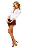 方格的女孩可爱的性感的短裙 库存照片