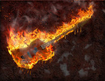 火焰状吉他熔化 免版税库存图片