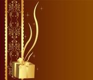 金黄背景的礼品 库存图片