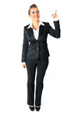 企业手指现代指向的微笑妇女 免版税库存照片