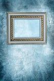 古色古香的框架冻结的墙壁 免版税库存照片