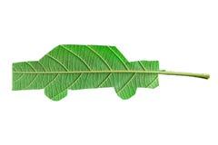 从叶子剪切的绿色汽车 免版税库存照片