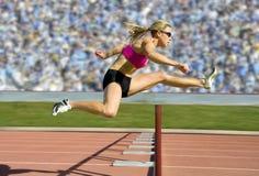运动员域跨栏赛跑者跟踪 库存照片