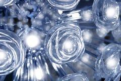 透明蓝色玻璃辉光灯轻的玫瑰 免版税库存照片