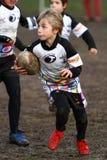 增进橄榄球比赛青年时期 免版税图库摄影