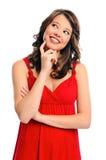 Думая женщина в красном цвете Стоковая Фотография RF