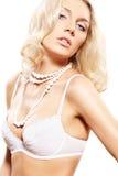 引诱的白肤金发的女用贴身内衣裤设&# 免版税库存照片