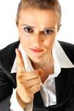 企业手指她的现代震动的严格的妇女 库存图片