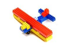 аэроплан преграждает игрушку здания Стоковая Фотография RF