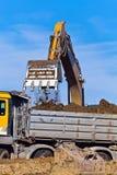 建筑挖掘机站点工作 免版税图库摄影