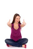Девушка показывая большие пальцы руки вверх Стоковые Фото