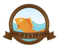 鱼金子徽标 库存照片
