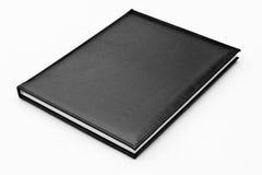 黑色盒查出的皮革笔记本 免版税库存图片