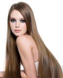 性感长期美丽的女孩的头发 免版税库存图片