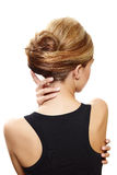 回到美丽的白肤金发的妇女 库存照片