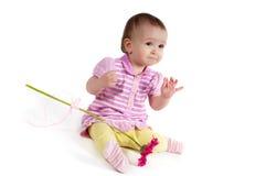 婴孩逗人喜爱的女孩粉红色 免版税库存图片