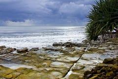 陆岬岩石风雨如磐 免版税库存图片