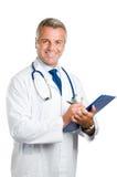 医生微笑的工作 免版税库存照片