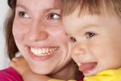 女儿妈妈微笑 免版税库存照片