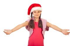 胳膊秀丽女孩开放圣诞老人 免版税库存图片