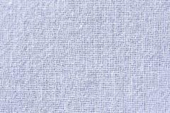 текстура тканья хлопко-бумажная ткани предпосылки к белизне Стоковые Изображения RF