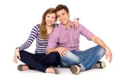 夫妇坐的年轻人 库存图片