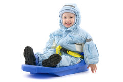 突然移动儿童雪撬 免版税库存图片