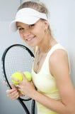 女孩愉快的球拍网球 库存照片