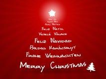 快活圣诞节不同的语言 免版税库存照片