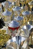 背景冠军杯做许多战利品 免版税库存照片