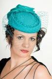 绿色帽子妇女 库存图片