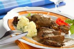 πατάτες χοιρινού κρέατος & Στοκ Εικόνα