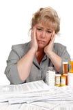 医疗保健法案痛苦的妇女 免版税库存图片