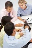 Смешанная группа в деловой встрече Стоковые Изображения