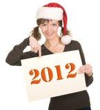 女孩帽子圣诞老人年轻人 免版税库存图片