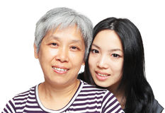 微笑母亲和女儿 免版税库存图片