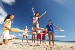 有海滩的乐趣少年 免版税库存照片