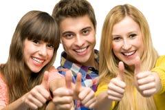 Νέοι με τους αντίχειρες επάνω Στοκ Φωτογραφία